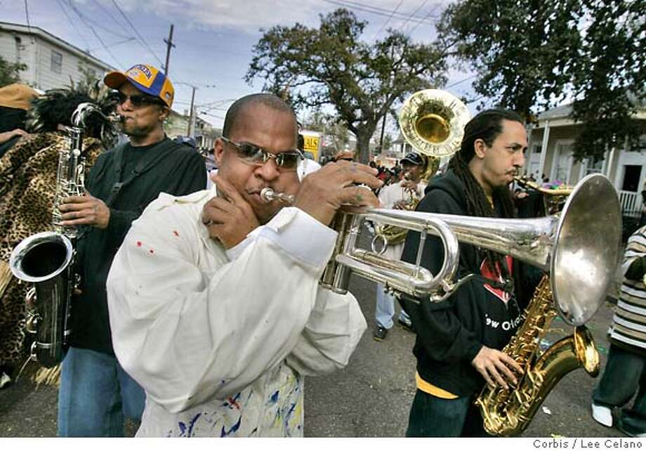 20 Feb 2007, New Orleans, Louisiana, USA --- Derrick Shezbie of the Rebirth Brass Band plays trumpet during the Zulu Mardi Gras parade in New Orleans. --- Image by � Lee Celano /Reuters/Corbis Photo: Lee Celano