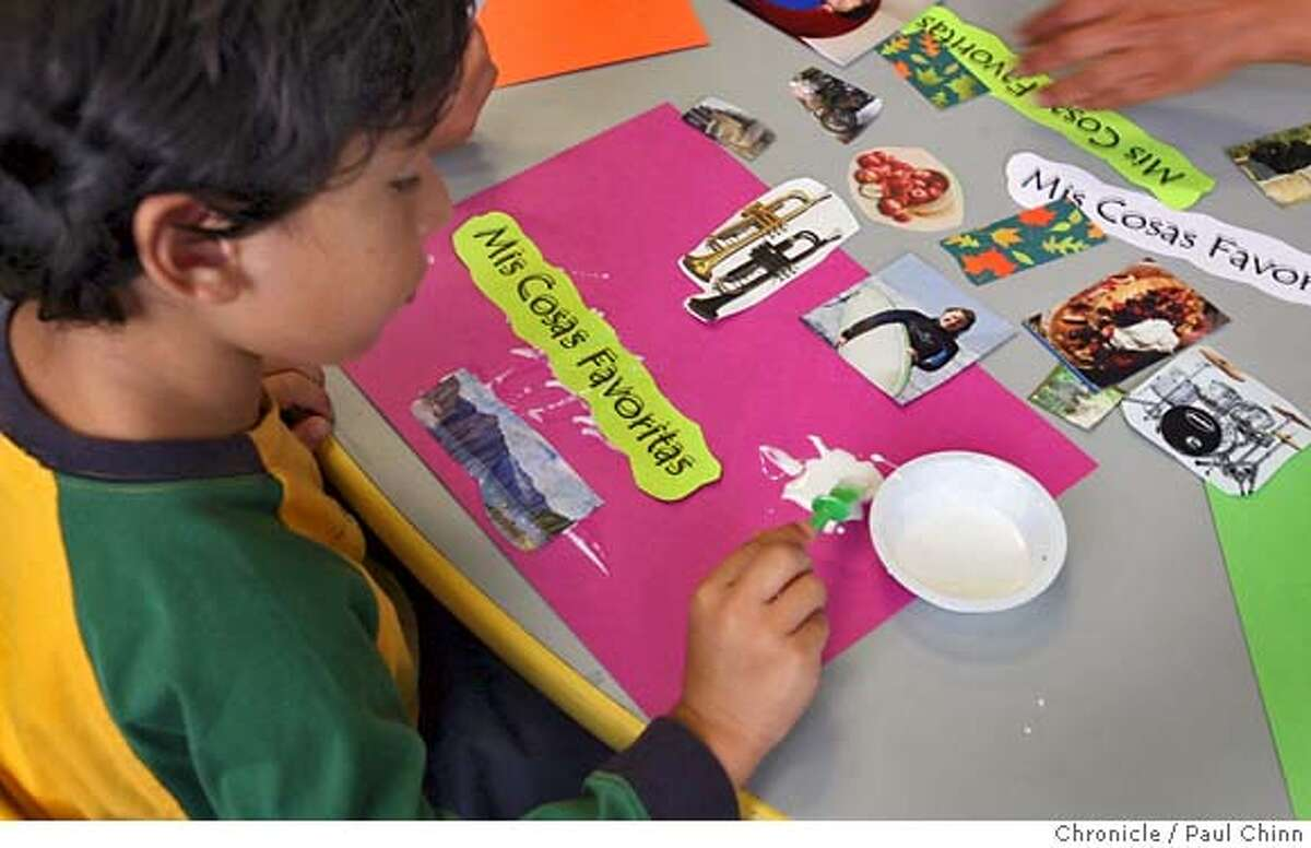 Aiden Aguirre, 5, makes a placemat depicting his favorite things in Jana McDonald's Kindergarten - 1st grade class at the Escuela Bilingue Internacional in Oakland, Calif. on Thursday, Sept. 6, 2007. The Spanish immersion school already has 110 students in its second year of operation. PAUL CHINN/The Chronicle **Aiden Aguirre, Jana McDonald MANDATORY CREDIT FOR PHOTOGRAPHER AND S.F. CHRONICLE/NO SALES - MAGS OUT
