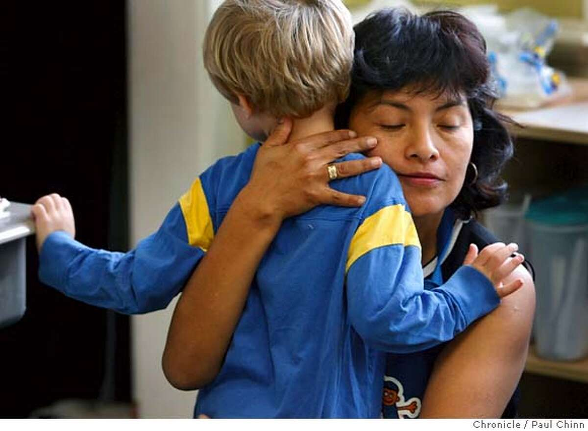 Teaching assistant Merly Chou offers support for Caleb Horsch at the Escuela Bilingue Internacional in Oakland, Calif. on Thursday, Sept. 6, 2007. The Spanish immersion school already has 110 students in its second year of operation. PAUL CHINN/The Chronicle **Merly Chou, Caleb Horsch MANDATORY CREDIT FOR PHOTOGRAPHER AND S.F. CHRONICLE/NO SALES - MAGS OUT