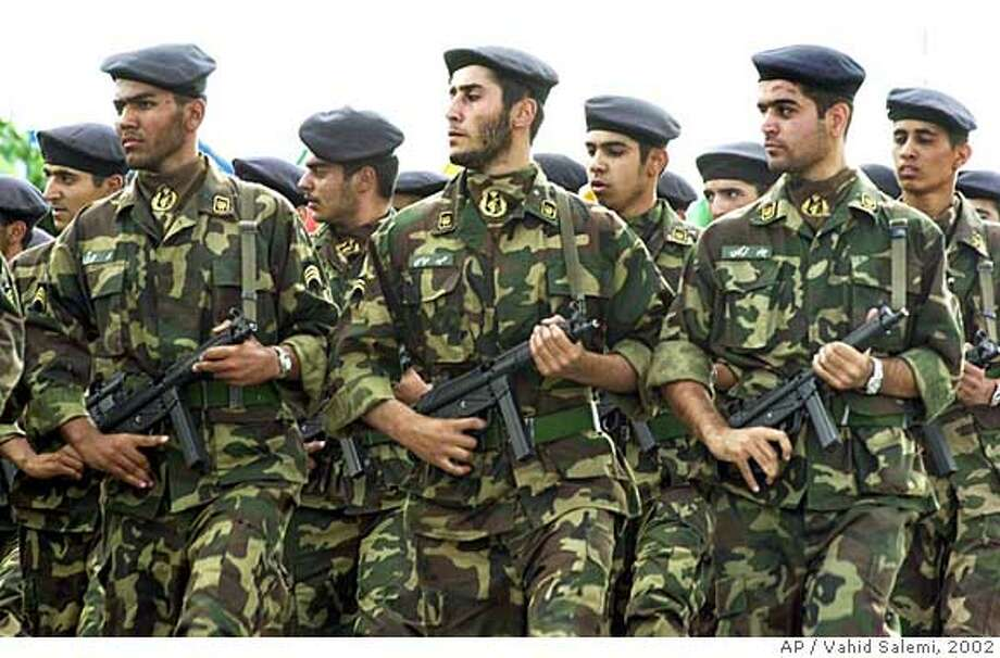 ** FILE ** Soldiers of Iran's elite Revolutionary Guards march during a parade on the 22nd anniversary of the outset of the Iran-Iraq 1980-1988 war in front of the mausoleum of the late revolutionary founder Ayatollah Khomeini in Tehran, in this Sunday, Sept. 22, 2002 file photo. A U.S. move to blacklist Iran's Revolutionary Guard Corps as a terror group, is a new salvo in a broader effort to choke off funding to Iranian elements accused of developing nuclear weapons and fomenting violence in Iraq, Afghanistan and the Middle East.(AP Photo/Vahid Salemi)  Ran on: 09-16-2007  Soldiers of Iran's Revolutionary Guard Corps march in a parade. Some officials in the White House and Vice President Dick Cheney's office are pushing to have the entire organization declared a terror group, but they are meeting resistance from the State and Treasury departments. Photo: VAHID SALEMI