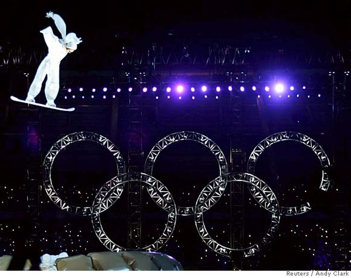 An artist performs on a snowboard during the closing ceremony of the Torino 2006 Winter Olympic Games in Turin, Italy, February 26, 2006. REUTERS/Andy Clark 0