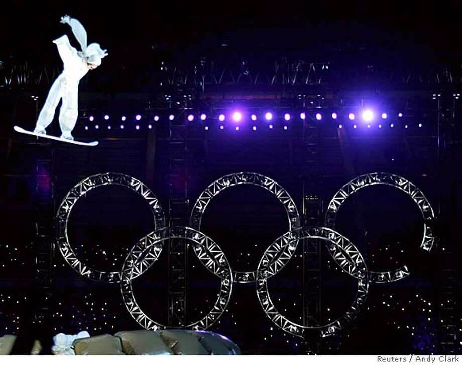 An artist performs on a snowboard during the closing ceremony of the Torino 2006 Winter Olympic Games in Turin, Italy, February 26, 2006. REUTERS/Andy Clark 0 Photo: ANDY CLARK