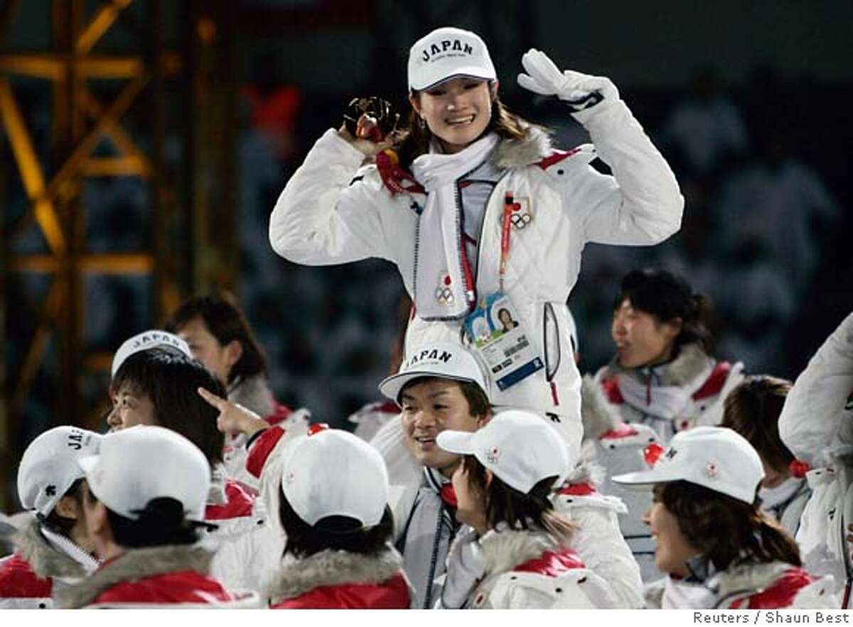 Japan's Arakawa is carried by her team mates during the closing ceremony at the Winter Olympic Games