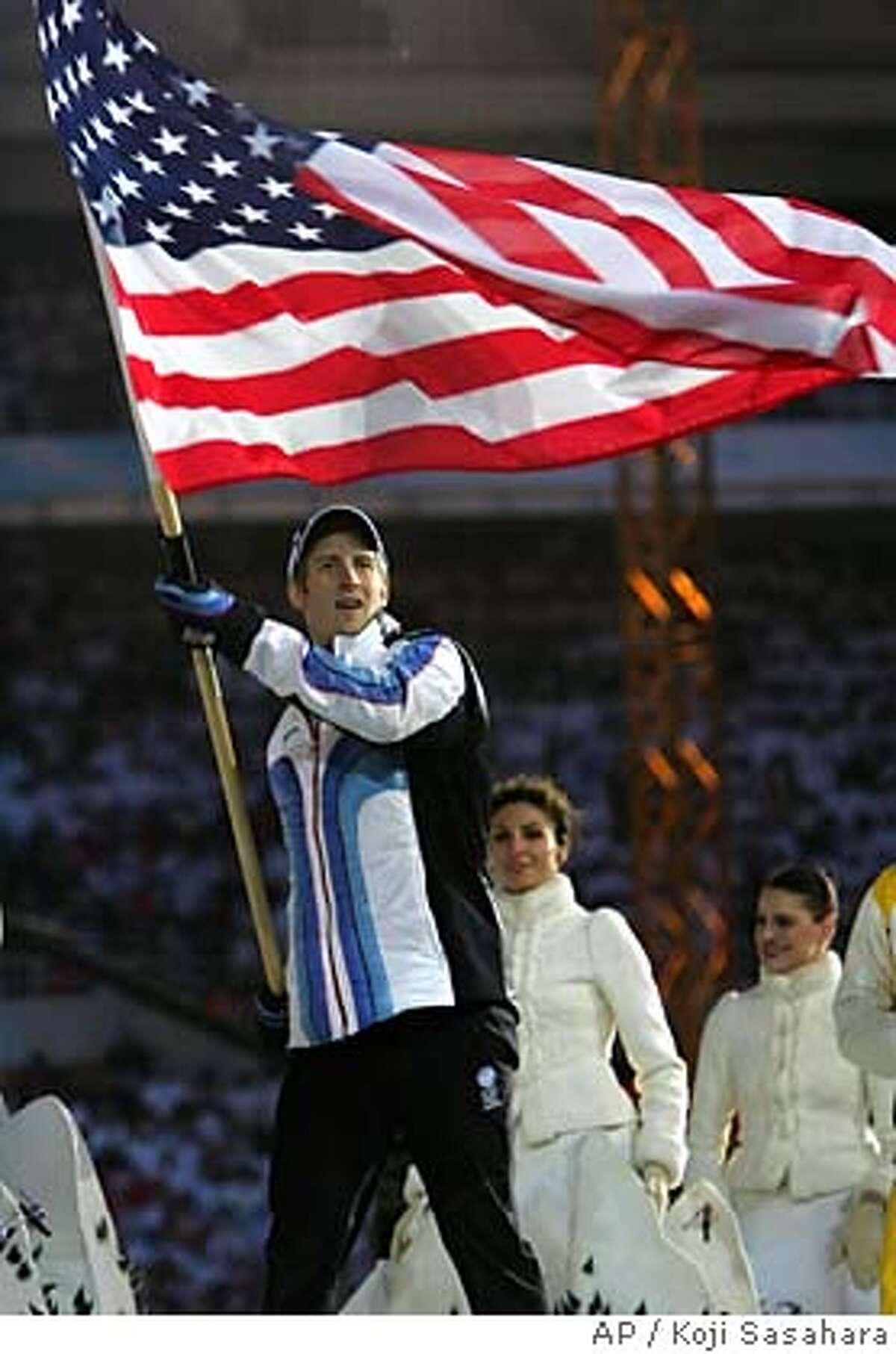 United States speedskater Joey Cheek holds an American national flag during the Winter Olympics closing cermeony in Turin, Italy, Sunday, Feb. 26, 2006. (AP / Koji Sasahara)