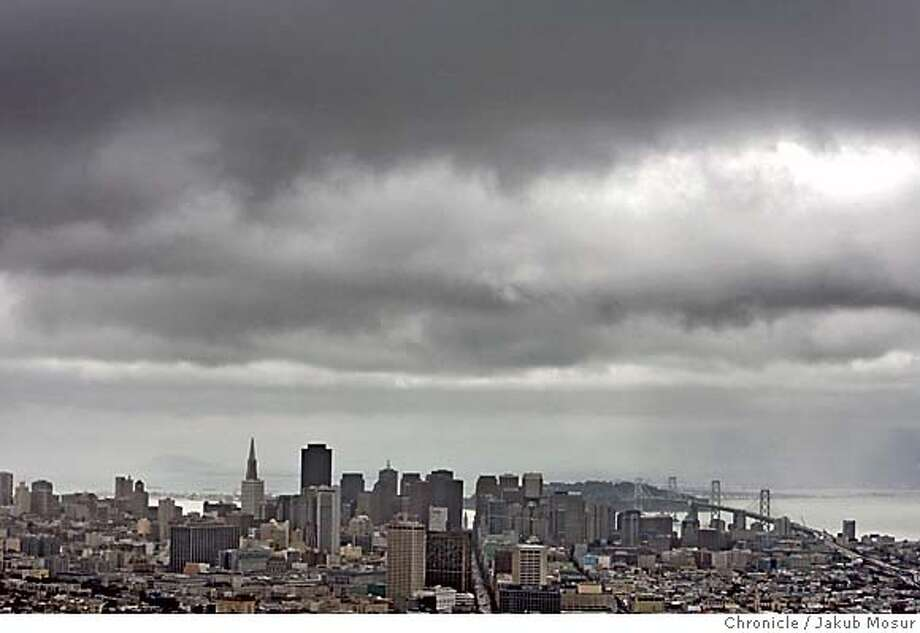 Dark storm clouds hang over downtown San Francisco on Monday, Feb. 27, 2006. Event on 2/27/06 in San Francisco. JAKUB MOSUR / The Chronicle Photo: JAKUB MOSUR