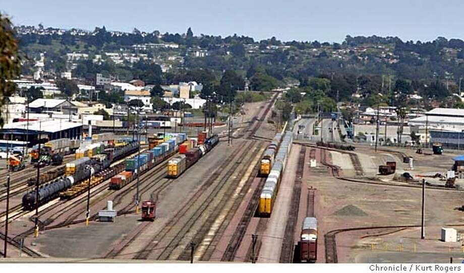 The Richmond train yard just north of the 580 freeway.  For decades, freight and passenger trains have wound their way along hills and valleys stretching from the Carquinez Strait to the Port of Oakland.  But an increase in East Bay train traffic heading to the port has communities like Richmond and Martinez seeing red. Longer trains mean longer waits at train crossings and more earsplitting whistles for growing communities nearby. Residents say it�s more than just a pain in the ear: Busy rail traffic leads to decreased property values and a decreased quality of life.  The dispute pits residents against the jobs and revenue generated by the railroads, whose presence dates back over 100 years.  Many tracks in the county run along clear hillsides or past isolated factories. But in places like Pittsburg, Clyde, parts of Martinez and Richmond, new housing is sprouting nearby, adding steam to residents who have long complained about the noise.  One such resident is Richmond's Rhonda Harris. She has had to get wheel alignments on her car because of damage from nearby train tracks CCTRAINS-kr039.JPG  Kurt Rogers/The Chronicle MANADATORY CREDIT FOR PHOTOG AND SF CHRONICLE/ -MAGS OUT Photo: Kurt Rogers