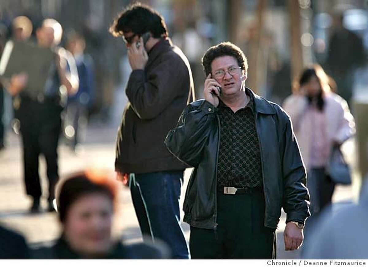 cellphone_df People talk on their cellphones while walking along Market Street in San Francisco. A study was released about how increasing cellphone use in our society is changing people's behavior. San Francisco Chronicle photo by Deanne Fitzmaurice