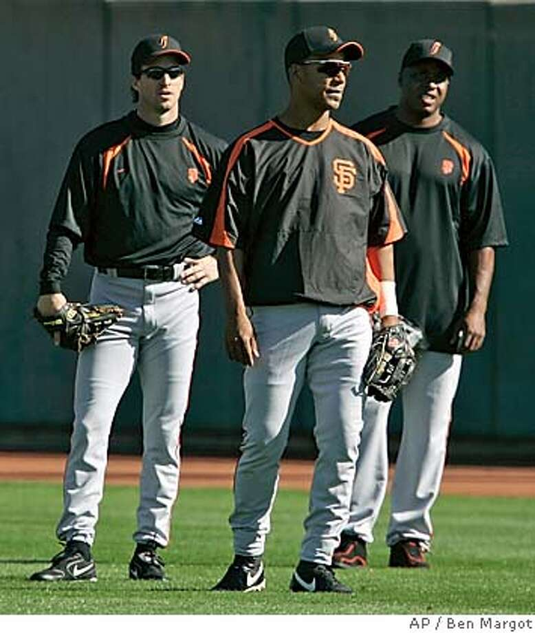 San Francisco Giants' outfielders from left, Steve Finley, Felipe Alou, and Barry Bonds seen during a Major League baseball spring training workout Wednesday, Feb. 22, 2006, in Scottsdale, Ariz. For most of his career, Steve Finley has never had to look at the lineup card to find out if he was starting that day. Since being called up to the majors by Baltimore in 1989, Finley has played more games in center field than any other player in the majors. Now for the first time since winning a full-time job with the Orioles in 1990, Finley is entering the season as a bench player, backing up Barry Bonds, Moises Alou and Randy Winn for the San Francisco Giants. (AP Photo/Ben Margot) Photo: BEN MARGOT