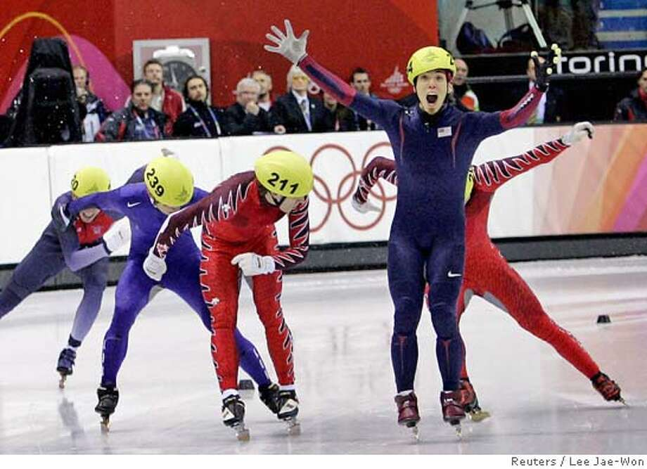 Apolo Anton Ohno (R) of the United States crosses the finish line to win gold in the men's 500 metres short track speed skating final at the Torino 2006 Winter Olympic Games in Turin, Italy February 25, 2006. Ohno won ahead of Francois-Louis Tremblay (211) of Canada, Ahn Hyun-Soo (239) of South Korea, Eric Bedard (R, rear) of Canada and Jon Eley (L) of Britain. REUTERS/Lee Jae-Won Photo: LEE JAE-WON