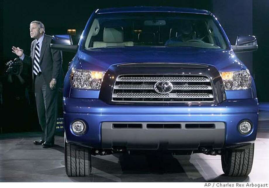** REMOVES REFERENCE TO CAR MODEL YEAR- TOYOTA DID NOT GIVE A MODEL YEAR FOR THIS VEHICLE **Jim Press, President and COO of Toyota Motor sales unveils the new Toyota Tundra truck at the Chicago Auto Show in Chicago, Thursday, Feb. 9, 2006. (AP Photo/Charles Rex Arbogast) REMOVES REFERENCE TO CAR MODEL YEAR- TOYOTA DID NOT GIVE A MODEL YEAR FOR THIS VEHICLE Photo: CHARLES REX ARBOGAST