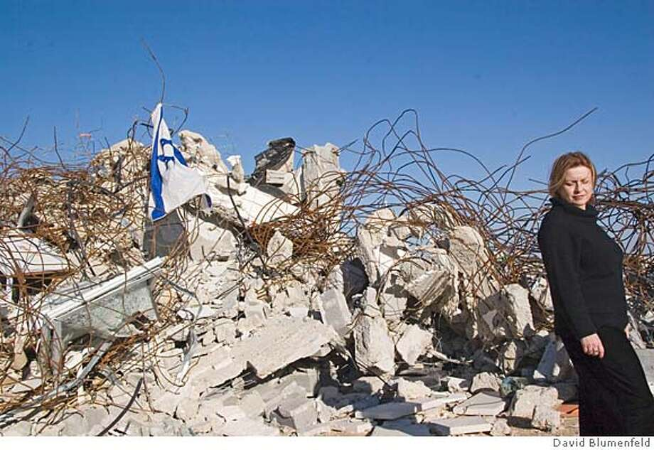 Amona Outpost, near Ofra, West Bank: February 23, 2006: Ruchie Avital of Ofra amidst the rubble of Amona after the IDF razed 9 homes several weeks ago in which many settlers and police were injured. �David BlumenfeldRan on: 02-26-2006  Ruchie Avital, shown amid the rubble of nine razed homes, believes the Israeli settlement of Ofra is &quo;being strangled&quo; by Israeli policies to block any West Bank development.Ran on: 02-26-2006  Ruchie Avital, shown amid the rubble of nine razed homes, believes the Israeli settlement of Ofra is &quo;being strangled&quo; by Israeli policies to block any West Bank development. Photo: Ccc