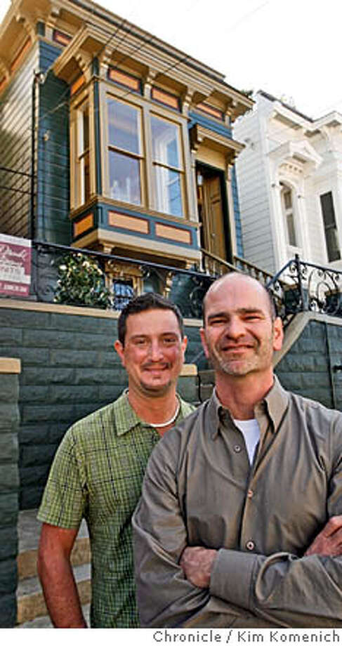 DUPLEX26_0049_KK.JPG  L to R Brian Lackey, Malcolm Davis in front of the 19th Street duplex they own.  Architect Malcolm Davis and his partner Brian Lackey own a duplex in the Castro. Originally, the house was being sold as a tear-down, even with plans for a new 3,500 square foot house, included. Davis decided to go a different way, preserving the  existing building. What we now have is two one-bedroom units, only about 700 square feet each, but they feel a whole lot bigger because of creative use of space and light.  San Francisco Chronicle photo by Kim Komenich  2/21/06 � Copyright 2006 Kim Komenich/San Francisco Chronicle Photo: Kim Komenich
