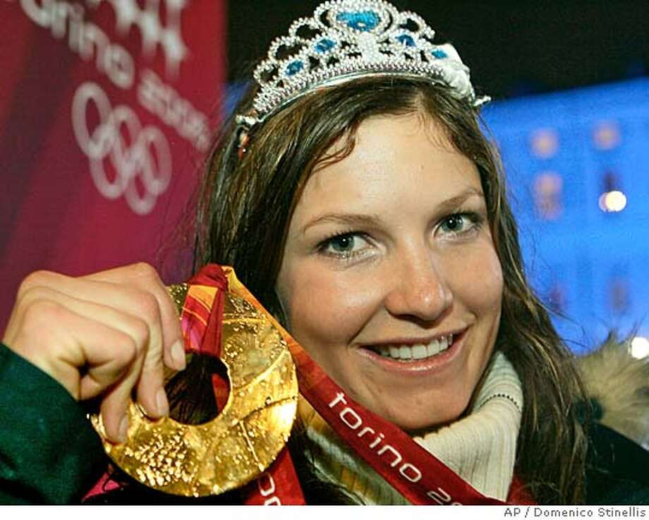 Gold medalist Julia Mancuso of the United States shows her medal during the medal ceremony for the Women's Giant Slalom at the Turin 2006 Winter Olympic Games in Turin, Friday Feb. 24, 2006. (AP Photo/Domenico Stinellis) Photo: DOMENICO STINELLIS