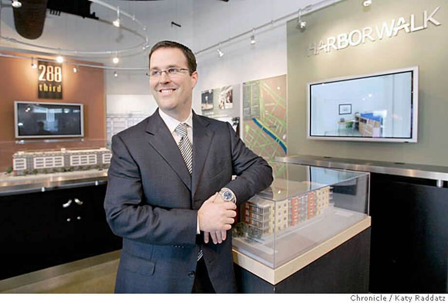 SALES26_018_RAD.JPG SHOWN: Mike Ghielmetti, president of Signature Properties, with virtual models of 288 Third St. and Harborwalk. Story is about one-stop virtual real estate sales centers. Builders are opening up sales storefronts with mock-ups of rooms, and using flat screen TV and big back-lit photo murals, create the feeling of the actual development. Photo taken on 2/13/06, in San Francisco, CA.  By Katy Raddatz / The San Francisco Chronicle MANDATORY CREDIT FOR PHOTOG AND SF CHRONICLE/ -MAGS OUT Photo: Katy Raddatz