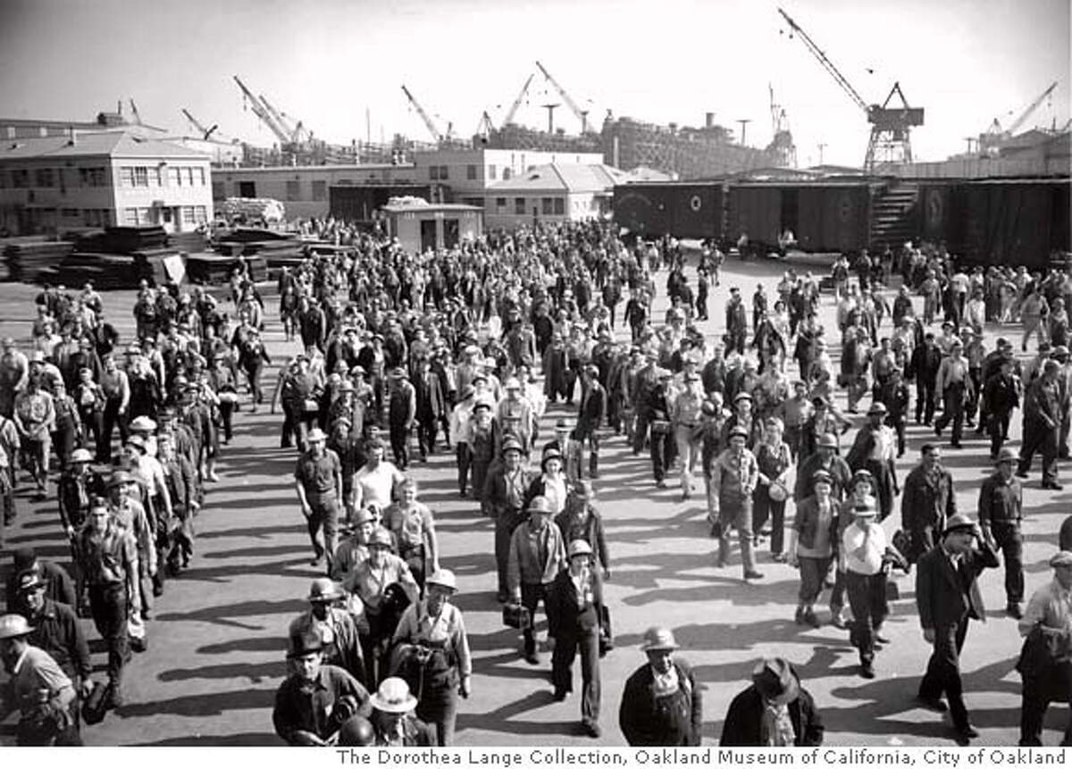 ONE-TIME PRINT AND ONLINE USE ONLY. SHIFT CHANGE 3:30 PM - COMING ON OF YARD 3 - KAISER SHIPYARDS. CIRCA 1942 EXACT AND NOT TO BE EDITED MANDATORY PHOTO CREDIT FOR ONE-TIME PRINT AND ONLINE USE: � The Dorothea Lange Collection, Oakland Museum of California, City of Oakland ONE-TIME PRINT AND ONLINE USE ONLY. ONE-TIME PRINT AND ONLINE USE ONLY.