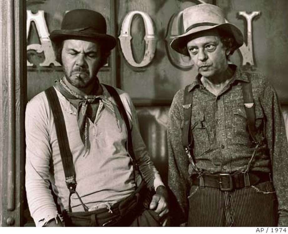 """**CORRECTS LAST NAME TO CONWAY** Tim Conway, left, and Don Knotts are seen in this 1974 photo in character for the film """"The Apple Dumpling Gang"""". Knotts, the skinny, lovable nerd who kept generations of television audiences laughing as bumbling Deputy Barney Fife on """"The Andy Griffith Show,"""" died Friday night, Feb. 24, 2006 of pulmonary and respiratory complications at Cedars-Sinai Medical Center in Beverly Hills. He was 81. (AP Photo) 1974 PHOTO **CORRECTS LAST NAME TO CONWAY** Photo: AP"""