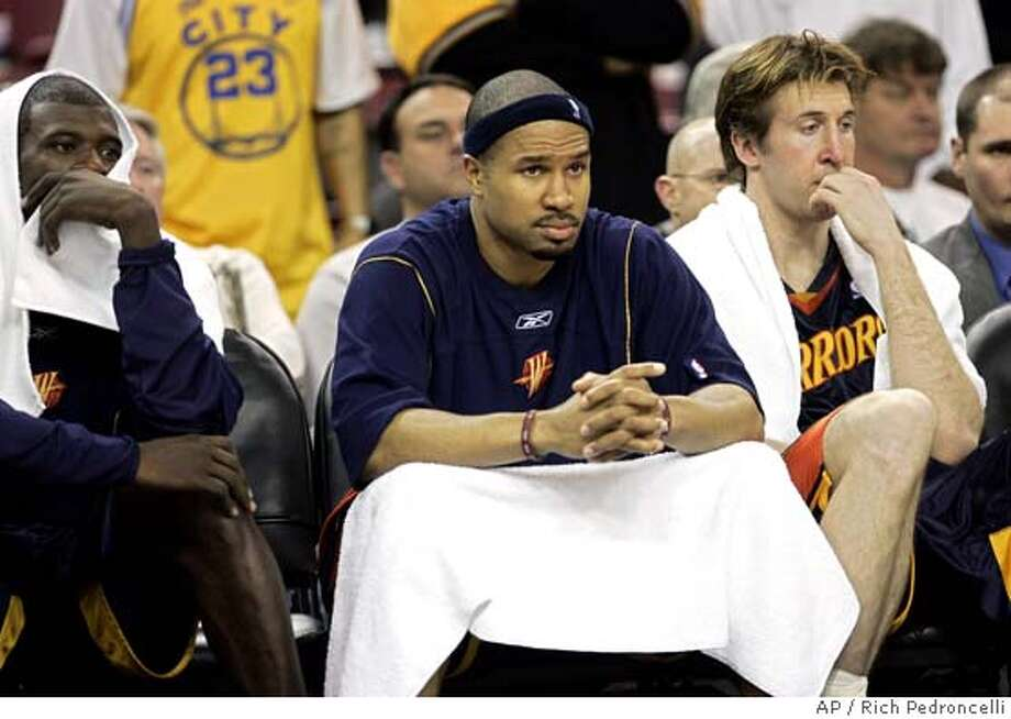 Golden State Warriors Jason Richardson, left, Derek Fisher, center and Troy Murphy, right, watch the closing seconds of their 102-77 loss to the Sacramento Kings in an NBA basketball game in Sacramento, Calif., Tuesday, Feb. 21, 2006.(AP Photo/Rich Pedroncelli) EFE OUT EFE OUT Photo: RICH PEDRONCELLI