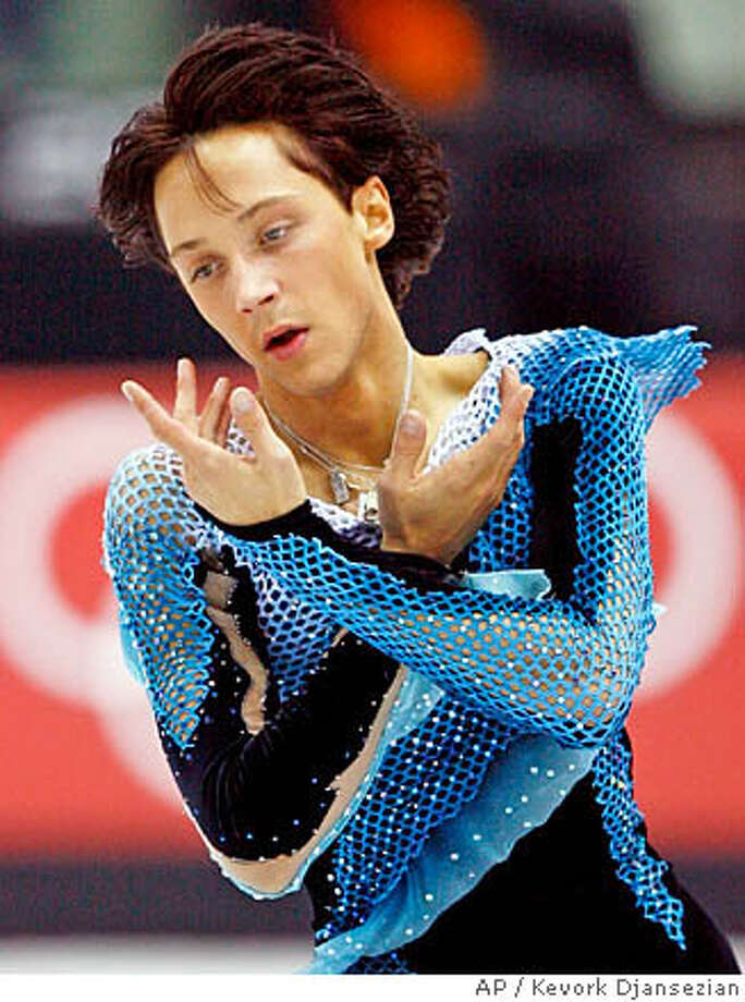 Johnny Weir wore a figure skating costume with sequins and fishnet at the Winter Olympics in Turin, Italy. Associated Press photo by Kevork Djansezian