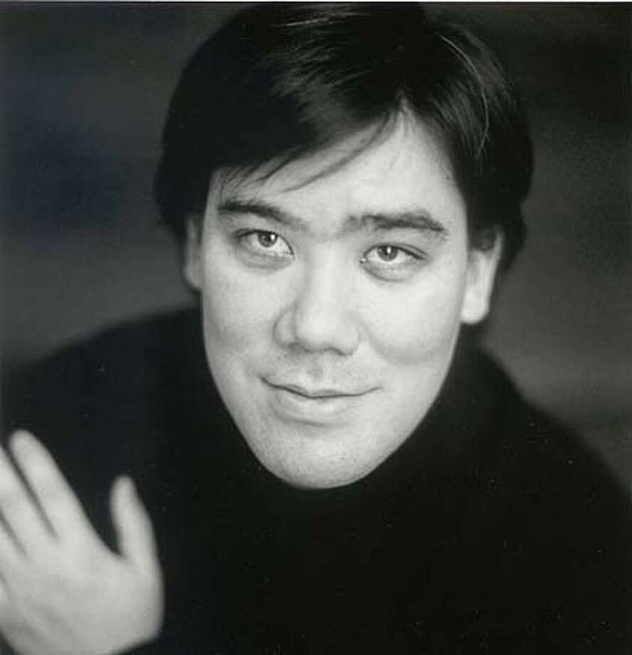 SYMPH03.jpg  Up-and-comer Alan Gilbert conducts Anders Hillborg preiere at the San Francisco Symphony. Ran on: 10-22-2004  Alan Gilbert CAT it's a mug, crop as needed Photo: HO