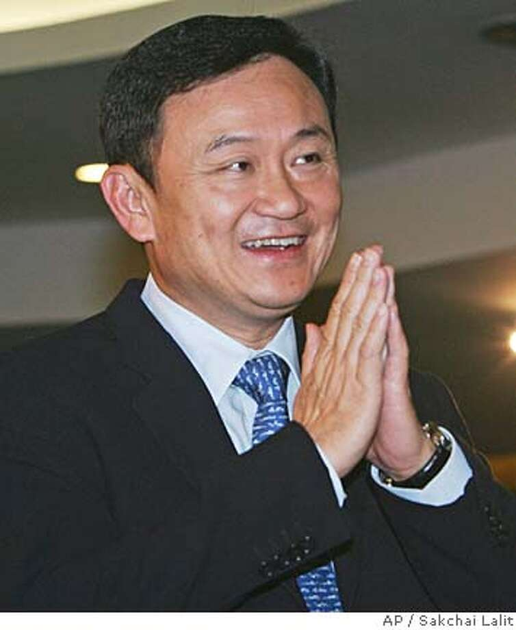 Thai Prime Minister Thaksin Shinawatra arrives at the office of Channel 9 television station to record a statement about his decision to dissolve the parliament Friday, Feb. 24, 2006 in Bangkok, Thailand. Thaksin dissolved parliament Friday, a move forcing national elections three years early and guaranteeing a showdown with his political opponents. (AP Photo/Sakchai Lalit) Photo: SAKCHAI LALIT