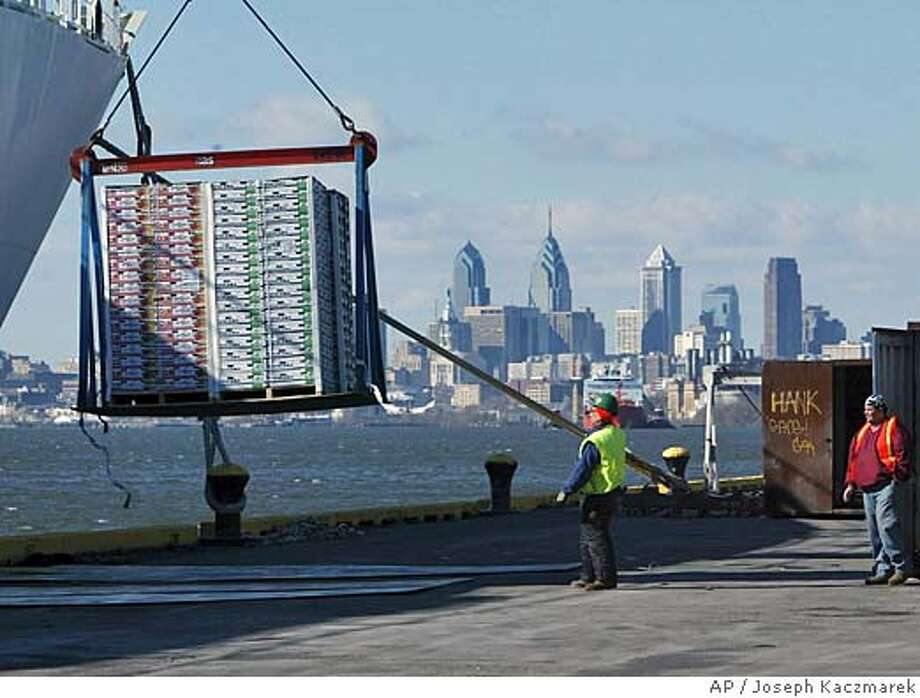 Longshoreman unload fruit from a container ship, Friday, Feb. 24, 2006, at the Tioga Marine Terminal in Philadelphia. Dubai Ports World has volunteered to postpone its takeover of significant operations at six major U.S. seaports, and the White House said on Friday the delay would help give the administration time to convince skeptical lawmakers the deal poses no increased risks from terrorism. (AP Photo/Joseph Kaczmarek) Photo: JOSEPH KACZMAREK