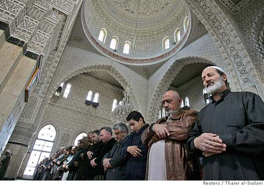Iraqis attend Friday prayers at a Sunni mosque in Baghdad February 24, 2006. An emergency curfew for Friday's Muslim day of prayer helped quell sectarian violence that has killed some 200 people around Baghdad, keeping much of the Iraqi capital deserted as leaders work to avert civil war. REUTERS/Thaier al-Sudani 0 Photo: THAIER AL-SUDANI