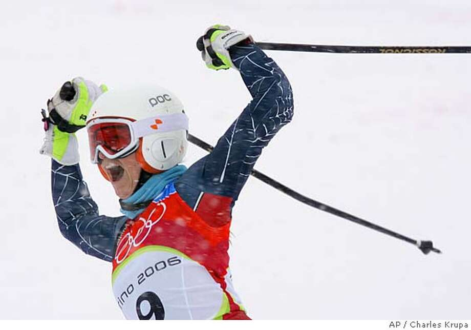 Julia Mancuso of the United States celebrates as she wins the Women's Giant Slalom at the Turin 2006 Winter Olympic Games in Sestriere Colle, Italy, Friday, Feb. 24, 2006. (AP Photo/Charles Krupa) Photo: CHARLES KRUPA