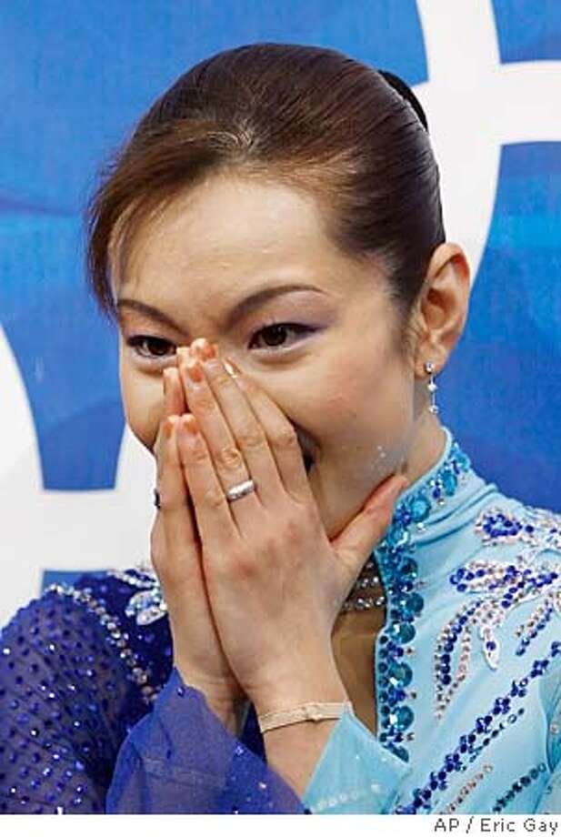 Gold medalist Japan's Shizuka Arakawa reacts when she sees her scores following her winning routine at the Women's Figure Skating final at the Turin 2006 Winter Olympic Games in Turin, Italy, Thursday, Feb. 23, 2006. (AP Photo/Eric Gay) Photo: ERIC GAY