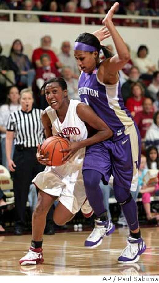 Stanford guard Candice Wiggins, left, drives past Washington forward Jill Bell, right, in the first half of their NCAA basketball game, Thursday, Feb. 23, 2006, in Stanford, Calif. (AP Photo/Paul Sakuma) Photo: PAUL SAKUMA