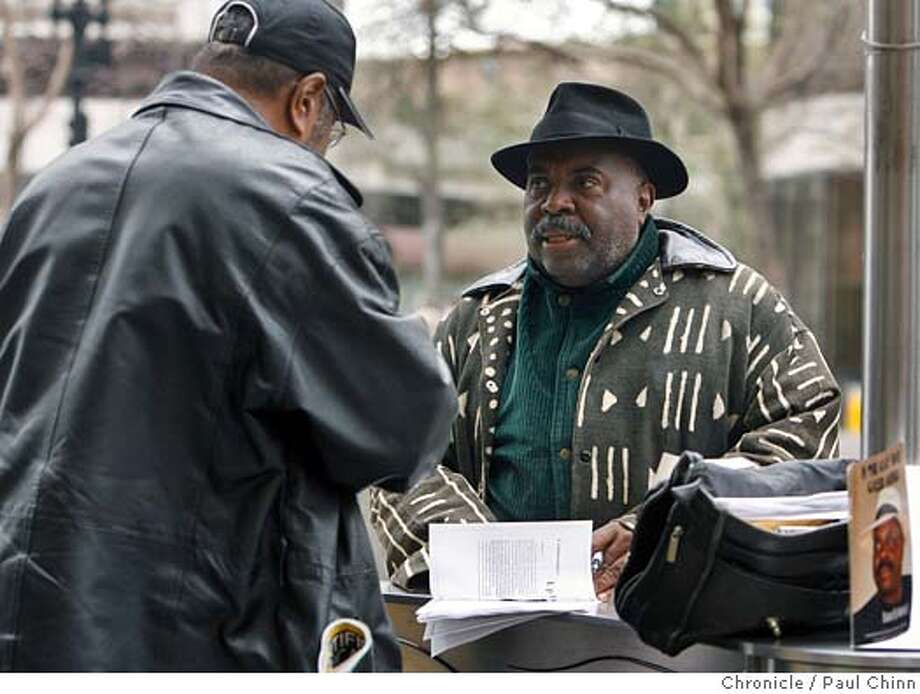 Author and arts activist Marvin X talks to Wilson Riles while selling his books along Broadway in downtown Oakland, Calif. on 2/17/06. He's a leader in the black arts movement and producer of the Tenderloin Book Fair and University of Poetry.  PAUL CHINN/The Chronicle MANDATORY CREDIT FOR PHOTOG AND S.F. CHRONICLE/ - MAGS OUT Photo: PAUL CHINN