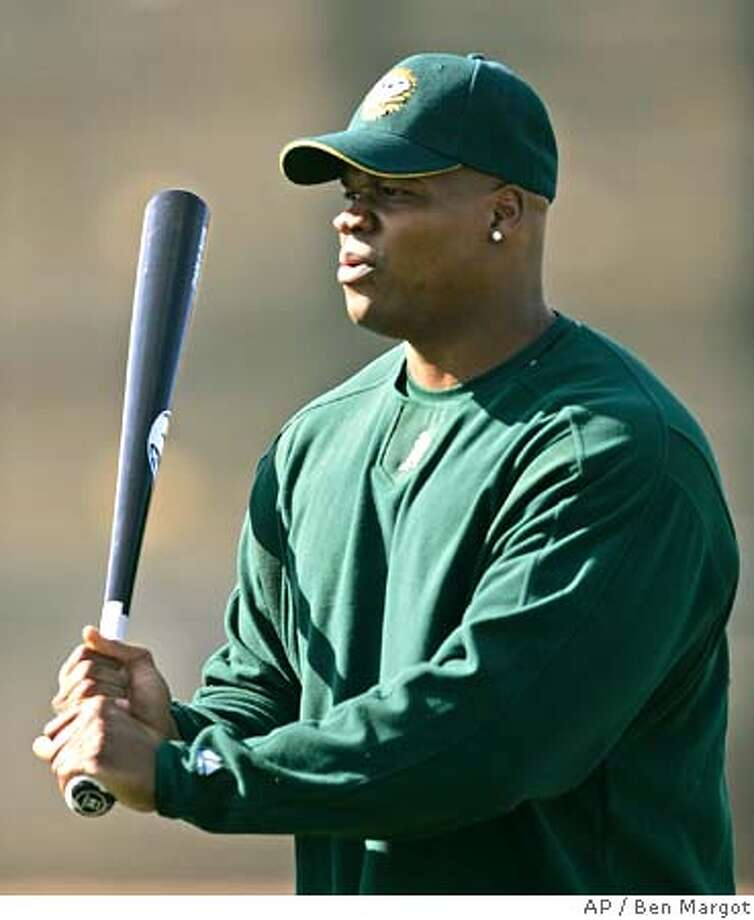 Oakland Athletics' Frank Thomas warms up his swing during a Major League baseball spring training workout Thursday, Feb. 23, 2006, in Phoenix. (AP Photo/Ben Margot) Photo: BEN MARGOT