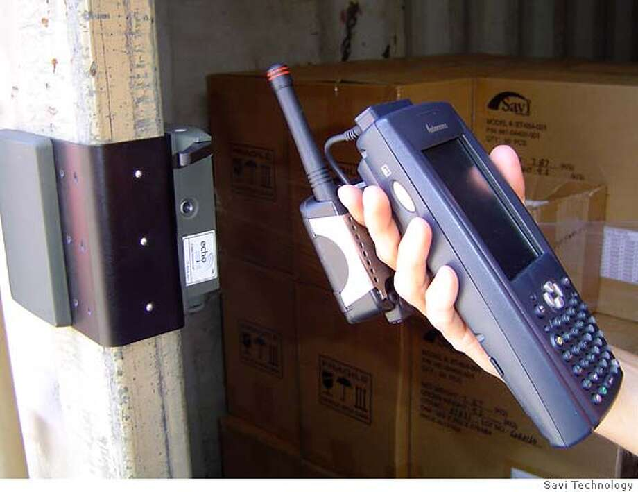 Image shows a person using a hand-held receiver to read a radio frequency security tag that is attached to a cargo box. The tag is used to detect security breaches and gather information about conditions inside the cargo box such as temperature changes. Source: Savi Technology