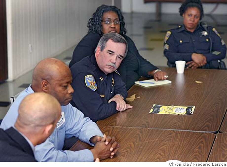 {object name} SFPD Captain Albert Pardini (center) talks to Pastor Floyd W. Trammell (far left bottom, back of head) as Tyrone Smith (blue shirt), Quieter Russ of Saint Paul Taberack (glasses) and SFPD Ava Garrick of the Bayview Station listen. NAACP is up in arms over SF police arrest and pepper-spraying of a member of a hip-hop gospel group who was taken into custody Saturday night as he walked by a broken window. Cop apparently thought he broke the window, then dosed him and a friend with pepper spray when they allegedly resisted arrest. Both have since been released. Bayview police sergeant, Eva Garrett, is going to the men's church today to explain to the congregation what happened. 2/23/06  Frederic Larson Photo: Frederic Larson