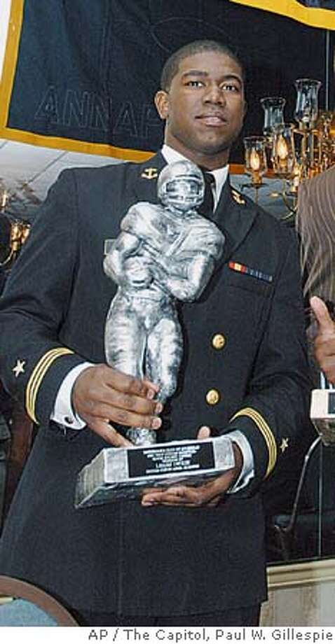 U.S. Naval Academy cadet Lamar Owens appears at the Annapolis Touchdown Club Banquet Feb. 16, 2006, in Annapolis, Md. The Naval Academy announced Wednesday, Feb. 22, 2006, that Owens has been charged with raping a female midshipman in her dormitory room. (AP Photo/The Capitol, Paul W. Gillespie) EFE OUT Photo: PAUL W. GILLESPIE