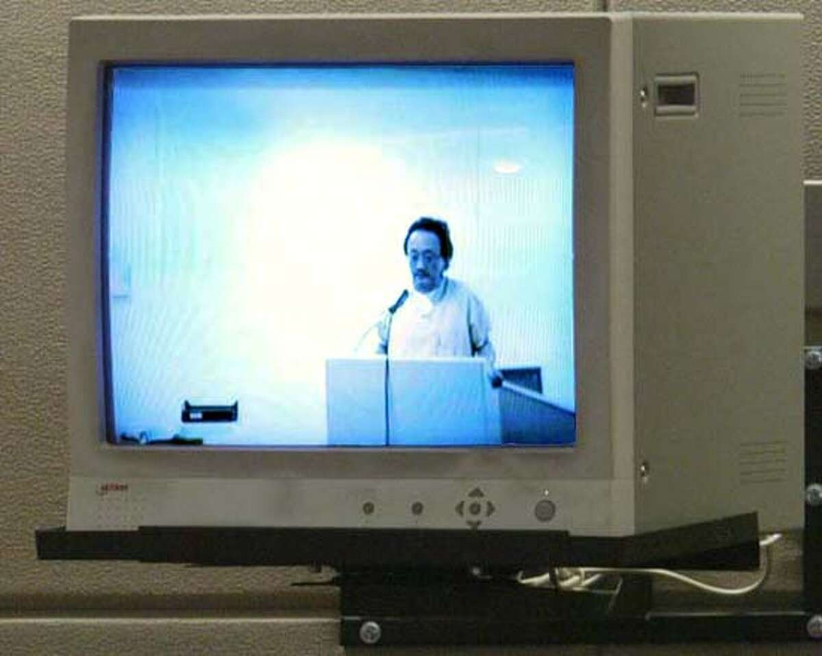 Norman Hsu appears on a video monitor during his bond hearing Thursday, Sept. 13, 2007, in Grand Junction, Colo. Mesa County Judge Bruce Raaum set bail at $5 million for the former Democratic fundraiser on a California grand theft charge. (AP Photo/Grand Junction Daily Sentinel, Gretel Daugherty) ** DENVER POST OUT ** DENVER POST OUT