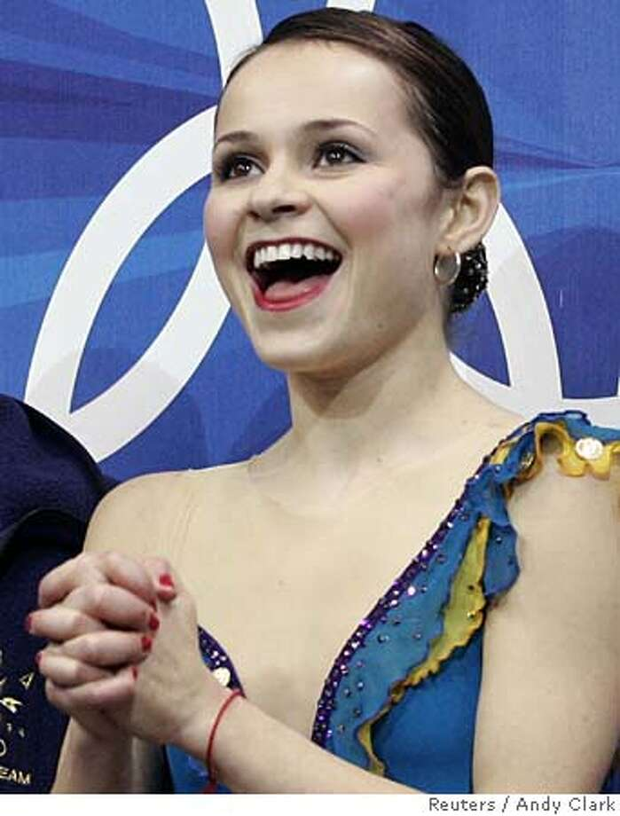 Sasha Cohen from the U.S. reacts after her women's short program during the Figure Skating competition at the Torino 2006 Winter Olympic Games in Turin, Italy, February 21, 2006. REUTERS/Andy Clark 0 Photo: ANDY CLARK