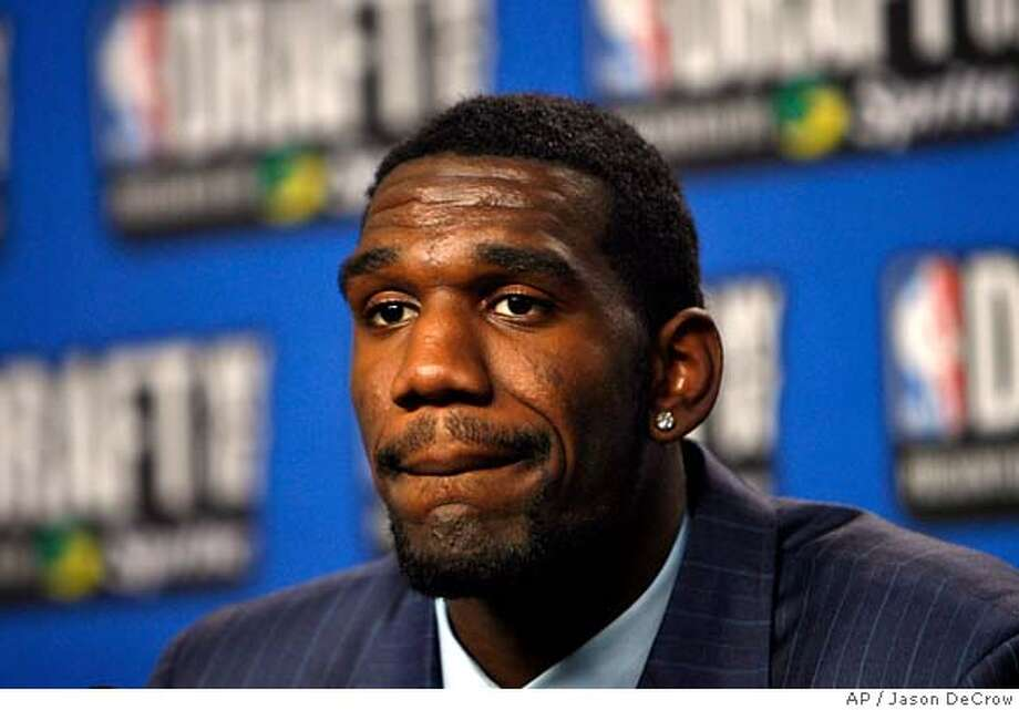 ** FILE ** Ohio State's Greg Oden takes questions in the interview room after being selected by the Portland Trail Blazers as the No. 1 overall pick in the first round of the NBA Draft on in this June 28, 2007 file photo. The Blazers say Oden will likely miss the 2007-08 season as a result of knee surgery Thursday, Sept. 13, 2007. (AP Photo/Jason DeCrow) A JUNE 28, 2007 FILE PHOTO Photo: Jason DeCrow
