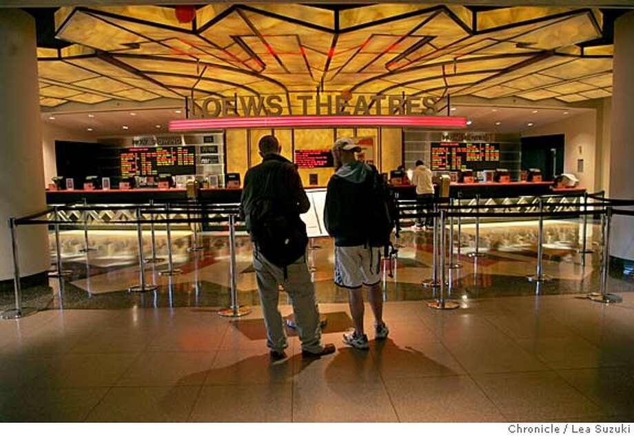 metreon23_066_ls.jpg  from left: Gavin Towart and Clint Davies both of San Francisco look over the movie selection at the Metreon.  Westfield Group and Forest Enterprises have bought the Metreon for an undisclosed sum. The Metreon was once a high flying retail center that has fallen on hard times. Very few folks are around, even at the lunch hour.  Photo taken on 2/22/06 in San Francisco, CA. Photo by Lea Suzuki/ The San Francisco Chronicle MANDATORY CREDIT FOR PHOTOG AND SF CHRONICLE/ -MAGS OUT. Photo: Lea Suzuki