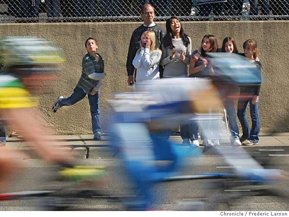 {object name} Redwood Christian Elementary school children got a curb side view of the second stage of the Tour of California bike race as the 100 riders blow through Castro Valley.  2/21/06  Frederic Larson Photo: Frederic Larson