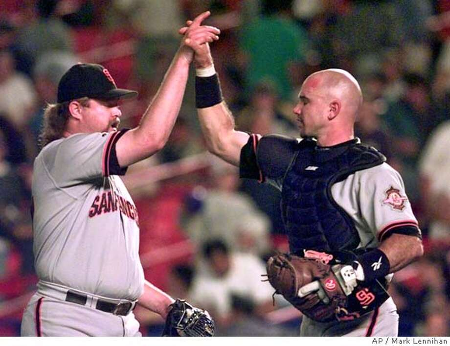 San Francisco Giants pitcher Rod Beck, left, and catcher Brian Johnson celebrate the Giants 6-2 win over the New York Mets Tuesday, Aug. 26, 1997 in New York. Beck pitched a scoreless ninth inning. (AP Photo/Mark Lennihan) DIGITAL CAMERA IMAGE Photo: MARK LENNIHAN