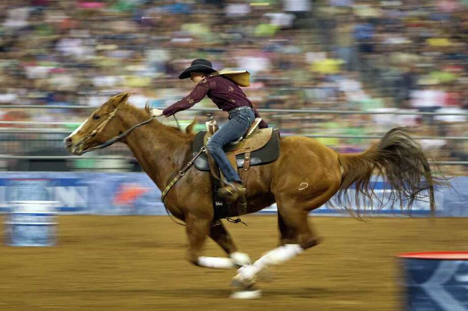 Lindsay Sears competes in the Super Series Championship Barrel Racing at the Houston Livestock Show and Rodeo on Saturday, March 17, 2012, in Houston. Sears won the championship in the event. Photo: Smiley N. Pool, Houston Chronicle / © 2012  Houston Chronicle