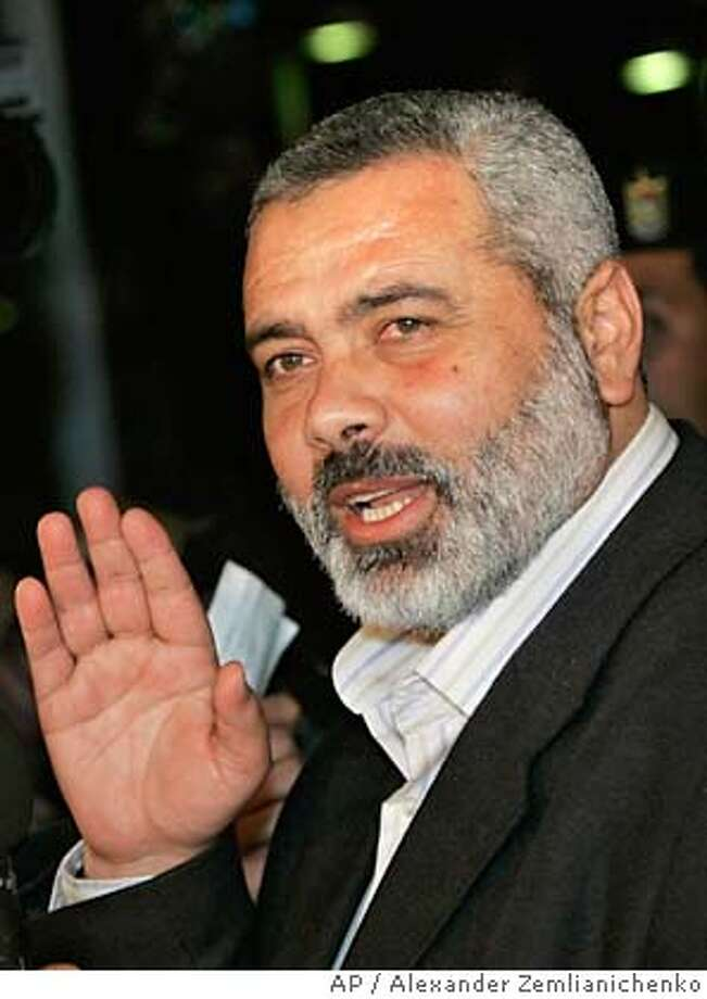 Hamas leader Ismail Haniyeh, appointed as the next Palestinian prime minister, waves as he leaves talks with Palestinian Authority President Mahmoud Abbas, also known as Abu Mazen, in Gaza City, Tuesday, Feb. 21, 2006. Hamas, which trounced Abbas' Fatah movement in legislative elections last month, already has begun the task of forming its government. It has held talks with several small factions since the new Hamas-dominated parliament took office Saturday and hopes to meet with Fatah soon.(AP / Alexander Zemlianichenko)