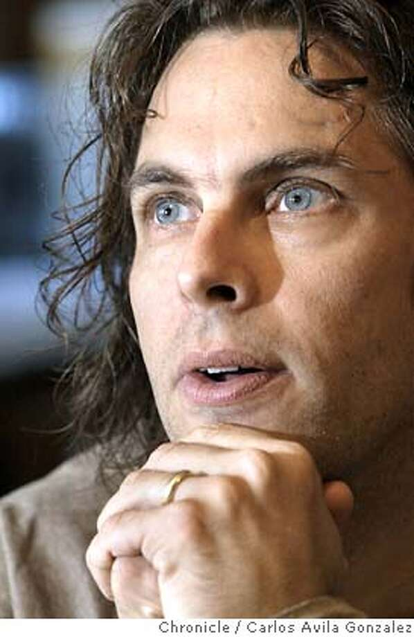"""CHABON18D-C-17SEP02-DD-CG --- Pulitzer Prize-winning Author Michael Chabon, looks off while considering how to answer a question in the kitchen of his Berkeley, Ca., home on Tuesday, September 17, 2002. He has recently completed his latest book, """"Summerland.""""  (BY CARLOS AVILA GONZALEZ/THE SAN FRANCISCO CHRONICLE) Photo: CARLOS AVILA GONZALEZ"""