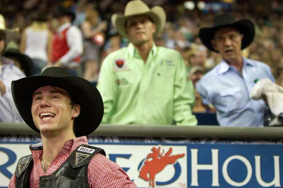 Beau Schroeder smiles after his ride in the Super Series Championship Bull Riding at the Houston Livestock Show and Rodeo on Saturday, March 17, 2012, in Houston. Schroeder won the championship in the event. Photo: Smiley N. Pool, Houston Chronicle / © 2012  Houston Chronicle