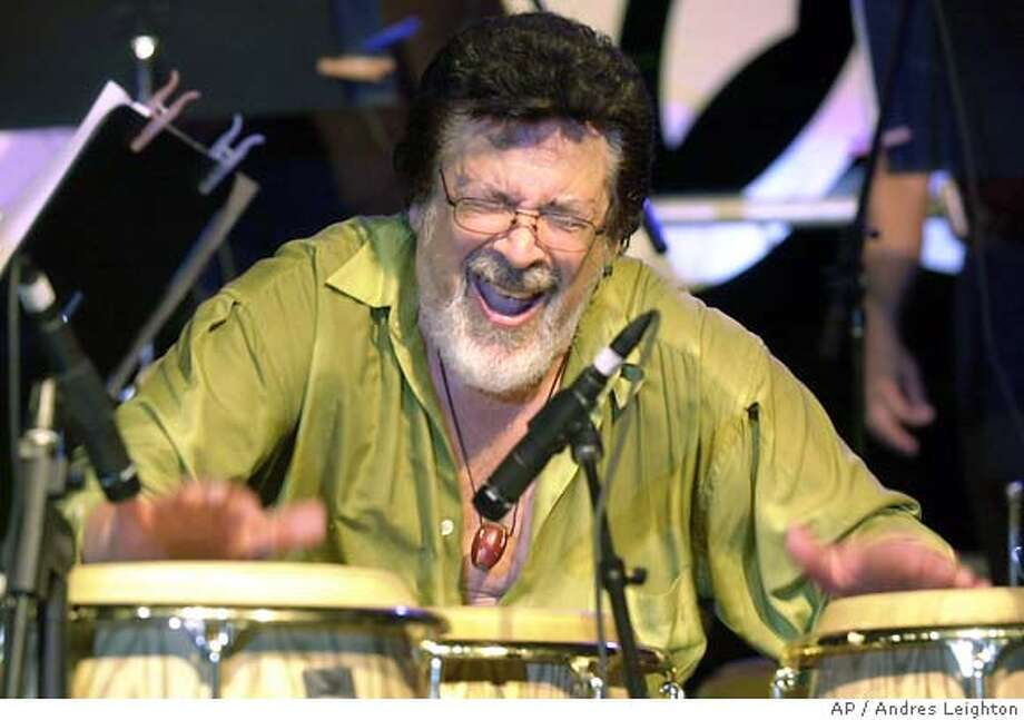 **FILE** Grammy-winning Latin jazz percussionist Ray Barretto plays the congas at the Tito Puente Auditorium in San Juan, Puerto Rico, in this Aug. 3, 2002 file photo. Barretto, who had heart bypass surgery last month and had pneumonia, died Friday, Feb. 17, 2006,at Hackensack, N.J., University Medical Center with his wife and two sons by his bedside, said spokesman George Rivera. (AP Photo/Andres Leighton, file) **EFE OUT** AUG. 3, 2002 FILE PHOTO ** Photo: ANDRES LEIGHTON