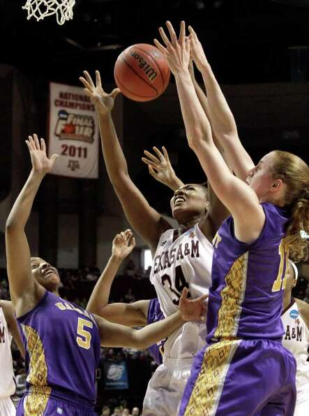 Texas A&M's Karla Gilbert (34) reaches for a rebound with Albany's Julie Forster (11) and Ebone Henr