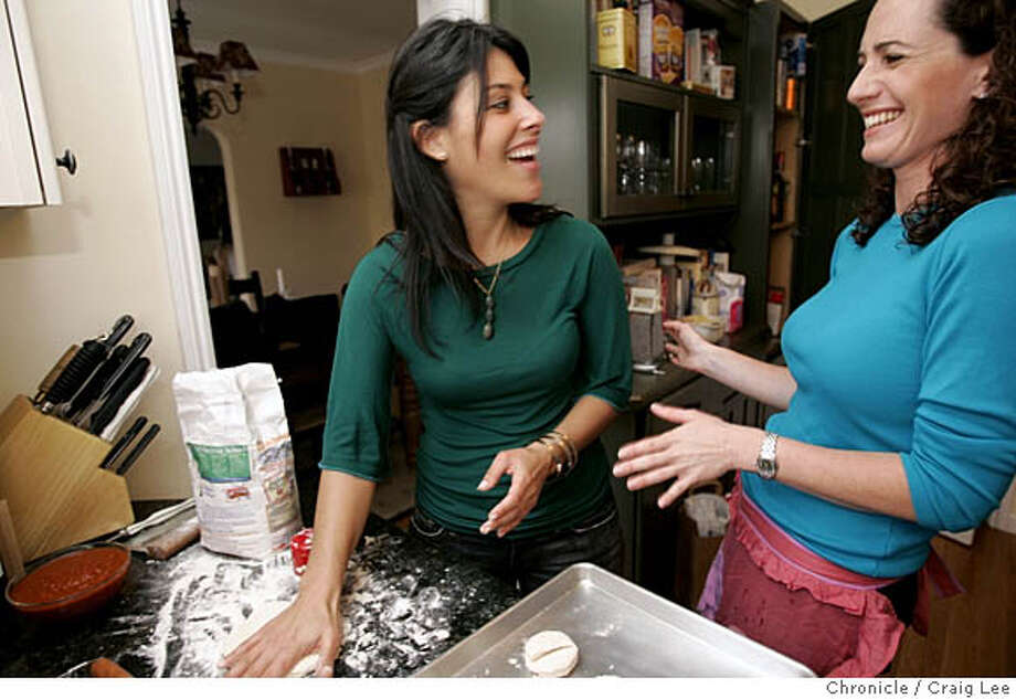 "HENPARTY22_020_cl.JPG  Last in a series about Sunday suppers by Amanda Berne. This one is about how to throw a ""hen party."" This was at Amanda Gold's apartment. Photo of Jennifer Strausburg (left) and Rachel Kirshman (right) making biscuits in the kitchen.  Craig Lee / The Chronicle MANDATORY CREDIT FOR PHOTOG AND SF CHRONICLE/ -MAGS OUT Photo: Craig Lee"