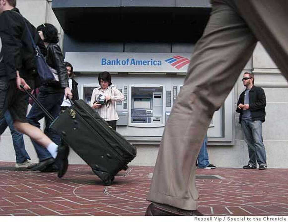 ATM14  Bank of America announced it is raising the rate to $3 from $2 for non-Bank of America customers to use Versateller machines like these at Powell and Market. Banking analysts believe other banks will soon follow. BY RUSSELL YIP/THE CHRONICLE Photo: RUSSELL YIP