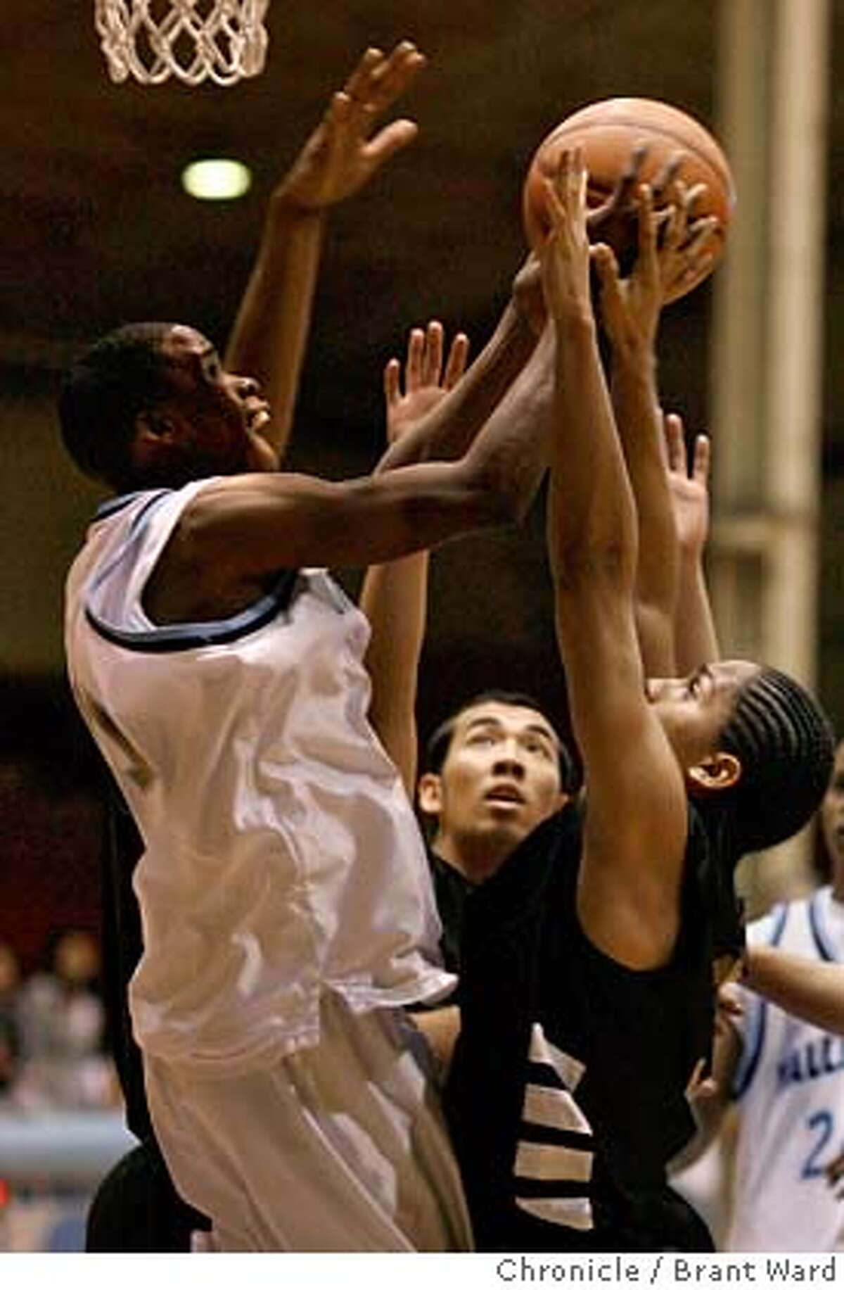aaa055_ward.jpg Wallenberg's Rodney Freeman, left, battled with ISA's Victor Zacca, right, for a rebound in first half action. Boys basketball action at Kezar Pavillion. Wallenberg High School, in white, against International Studies Academy (ISA), in black jerseys. Brant Ward2/22/06