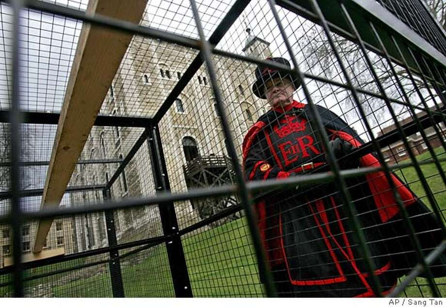 Derrick Coyle, Yeoman Raven Master, looks into an empty breeding cage at the Tower of London where the Tower's six ravens should normally reside but are now locked inside a castle's tower, as a precaution to protect the ravens from Avian Flu , Tuesday, Feb 21, 2006. (AP / Sang Tan)